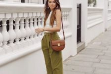 13 a casual summer outfit with a white sleeveless top, olive green slouchy pants and white sneaker splus a saddle crocodile bag