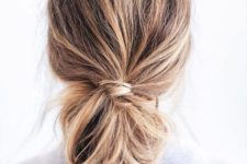 13 a messy bun made out of a low ponytail and a messy bump for every day