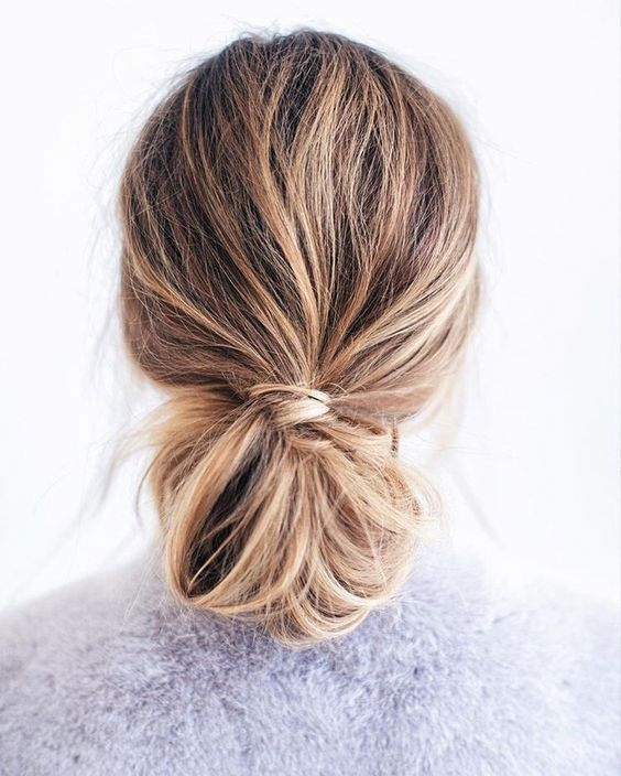 a messy bun made out of a low ponytail and a messy bump for every day