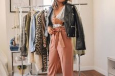 13 a spring look with a white top, pink paper bag pants, silver heels and a black leather jacket
