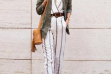 13 a summer look with a striped jumpsuit, brown laser cut shoes, an olive green cargo jacket, a brown bucket bag