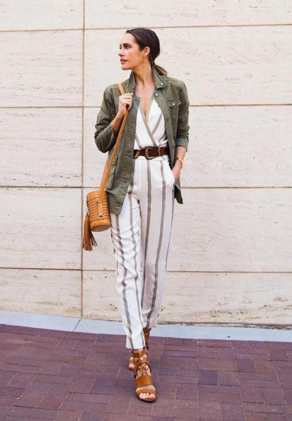 a summer look with a striped jumpsuit, brown laser cut shoes, an olive green cargo jacket, a brown bucket bag