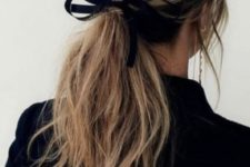 14 a low messy ponytail with textural hair down and a ribbon is a timeless idea that works for every type of hair
