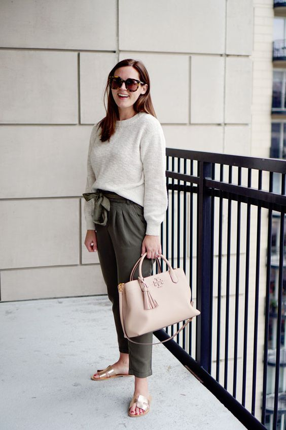 a spring outfit with a white top, gren paper bag pants, silver slippers and a blush bag