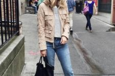 14 a tan cargo jacket, a striped tee, blue cropped jeans, white sneakers and a black tote bag