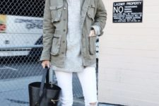 15 a winter outfit with an oversized grey sweater, white skinnies, white skinnies, a green cargo jacket and a black bag