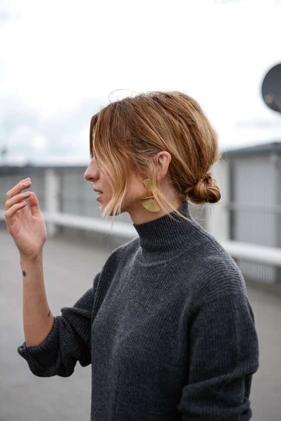 a low bun messy updo with much texture and ombre hair down is a trendy casual hairstyle