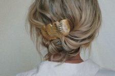 16 a wavy low updo secured with a pretty gold barrette, which is a hot trend for now