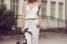 With beige ankle strap shoes and suede bag