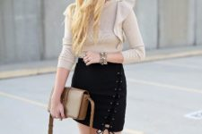 With beige ruffled shirt, brown leather bag and gray over the knee boots