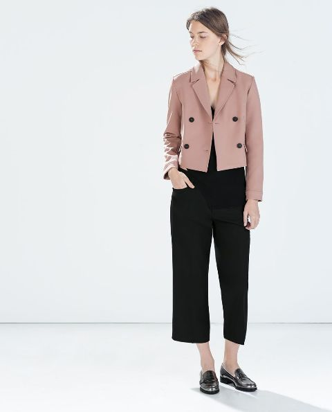 With black culottes, black flat shoes and top