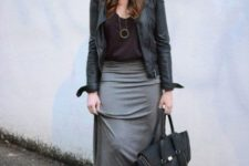 With black hat, black top, leather jacket, black boots and tote bag