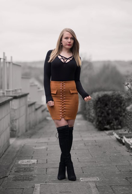 With black lace up shirt and black suede boots