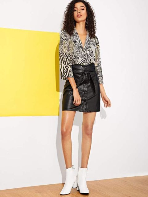 With black leather belted skirt and white boots