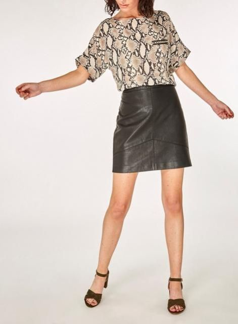 With black leather mini skirt and brown sandals