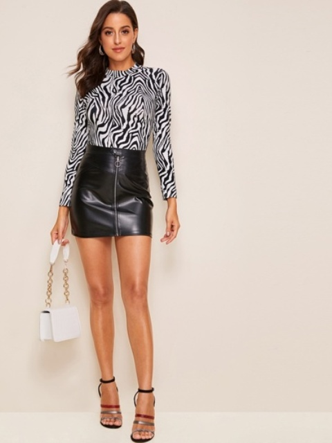 With black leather mini skirt, white mini bag and ankle strap shoes