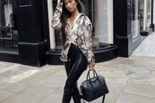 With black leather pants, high heels and black bag