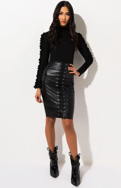 With black long sleeve turtleneck and black patent leather boots