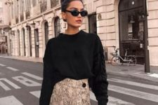 With black loose sweater, sunglasses and black bag