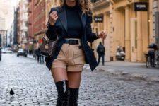 With black shirt, blazer, beige shorts and printed mini bag