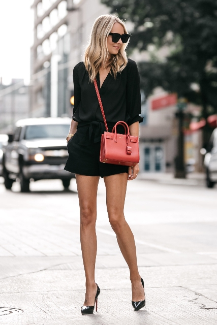 With black shirt, red bag and black shorts
