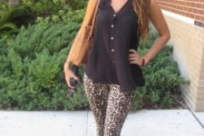 With black sleeveless loose top, pale pink flat shoes and brown bag