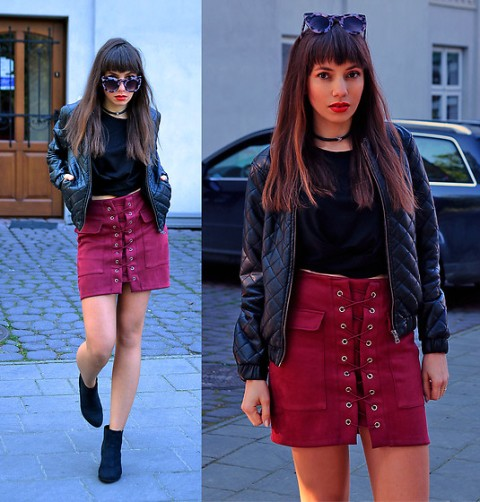 With black t-shirt, bomber jacket and ankle boots