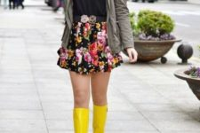 With black t-shirt, gray jacket and yellow rain boots