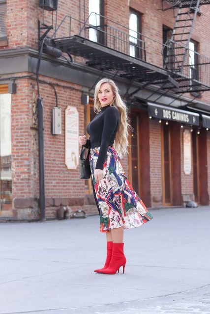 With black turtleneck, mini bag and red ankle boots