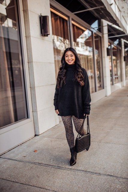 With black turtleneck sweater, chain strap bag and black ankle boots