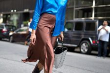 With blue satin shirt, tote bag and black high boots