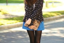 With blue skirt, golden clutch, black and white shoes and shirt