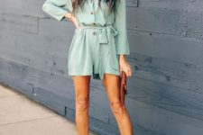 With brown clutch and ankle strap shoes