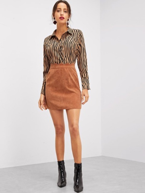 With brown suede high-waisted mini skirt and black patent leather ankle boots