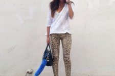 With cobalt blue pumps and fur and leather bag