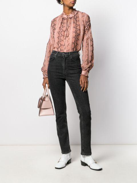 With dark gray jeans, white flat boots and pale pink bag