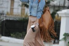 With denim button down shirt, leather fringe bag and suede boots