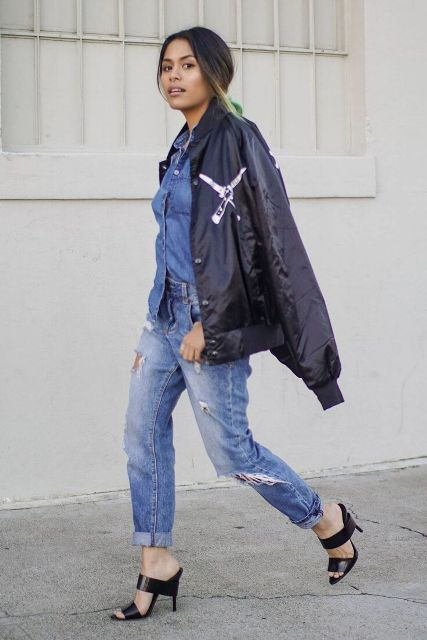 With denim shirt, cuffed jeans and black mules
