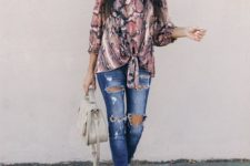 With distressed jeans, gray bag and shoes