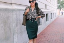 With emerald knee-length skirt, gray tote bag and black shoes
