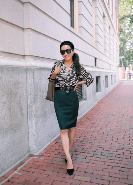 With emerald knee length skirt, gray tote bag and black shoes