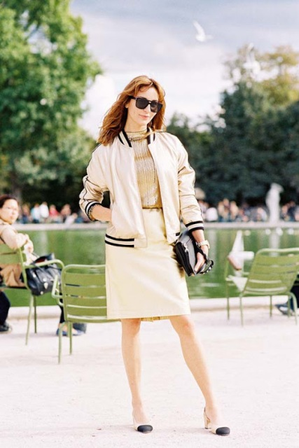 With golden shirt, beige skirt, two colored shoes and black clutch