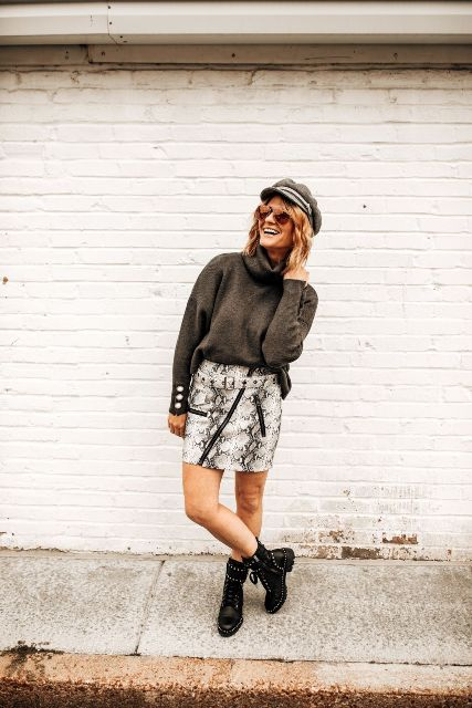 With gray cap, sweater and black embellished boots