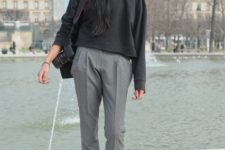 With gray loose shirt, gray cuffed trousers, wide brim hat and platform shoes