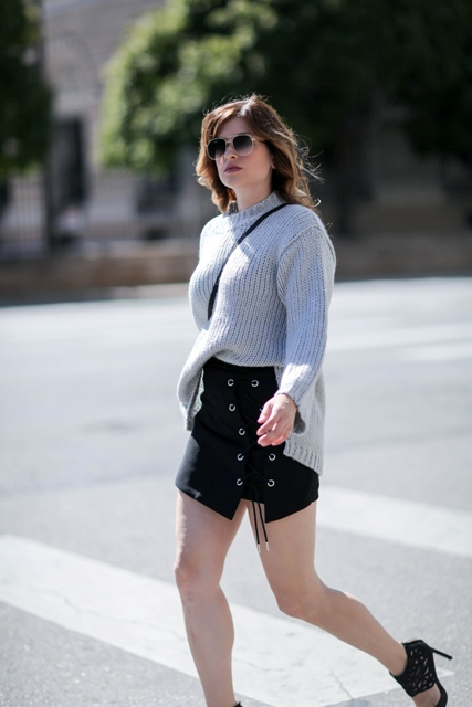 With gray oversized sweater, crossbody bag and high heels