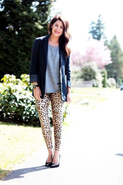 With gray shirt, navy blue blazer and black pumps
