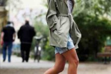 With gray t-shirt, denim shorts and olive green cardigan