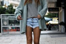 With gray t-shirt, mint green cardigan, hat and denim shorts