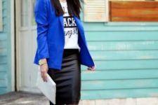 With labeled t-shirt, blue blazer, white clutch and lace up shoes