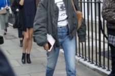 With labeled t-shirt, cropped jeans, fur bag and boots